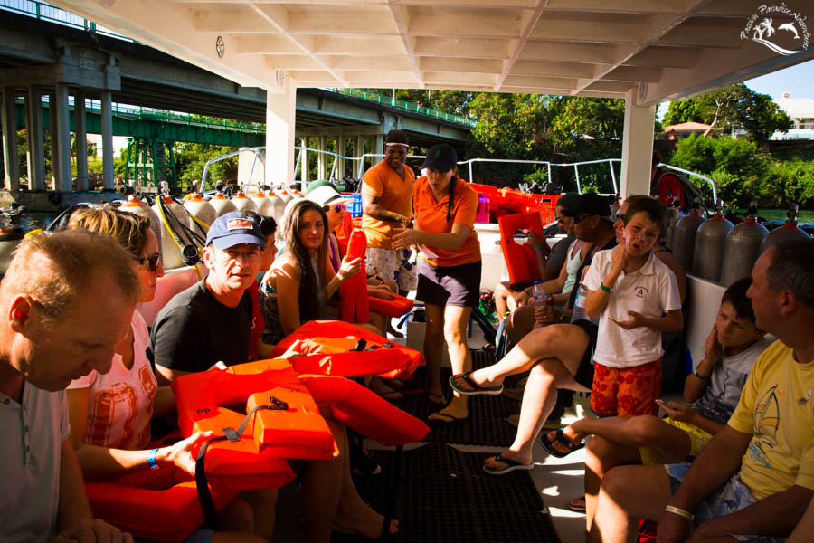 Guests receiving the life jackets and national park entry