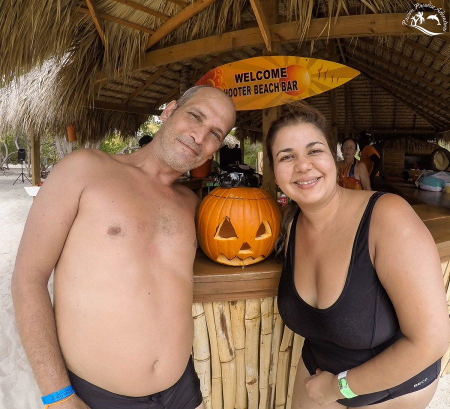 Guest enjoying their photo taken with the pumpkin our private beach bar on Catalina Island